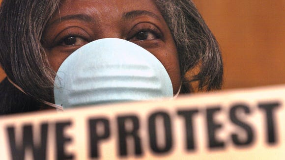 Gracie Lewis of the group Rubbertown Emergency Action is shown at a 2005 Louisville Metro Air Pollution Control Board when the board adopted its Strategic Toxic Air Reduction program.
