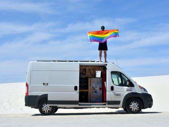 Mikah Meyer stands atop his van at White Sands National