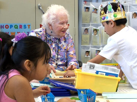 Marshall W. Errickson Elementary School volunteer Helen Coons works with kindergarten students at the Freehold Township school Wednesday, April 5, 2017.  She is one of the volunteers from the Applewood retirement community serving as teaching aides for school.
