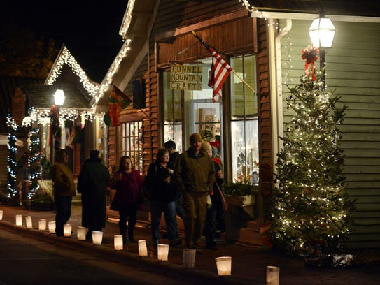 Holiday shoppers walk along Front Street in Dillsboro
