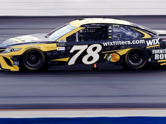 Driver Martin Truex Jr.(78) enters Turn 2 during the