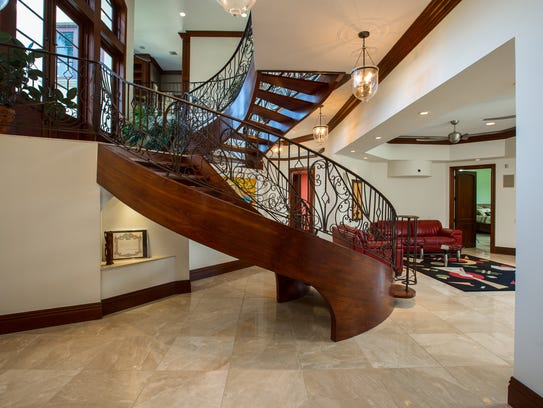 "This $4.5 million custom-built, six-bedroom seven-bath home on 1.2 acres is in the ""Estate Section"" of Hutchinson Island and has a floating staircase."