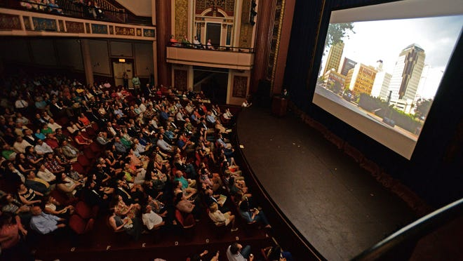 """Theatergoers watch as the introduction for """"Shape of Shreveport"""" is played during the documentary series premiere June 4 at The Strand Theatre."""