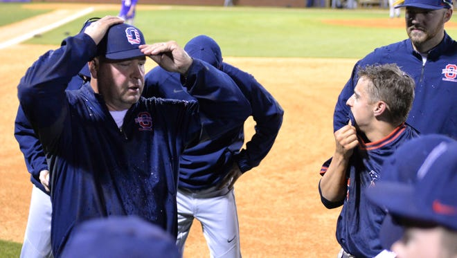 Oakland coach Mack Hawks (left) will be inducted into the Tennessee Baseball Coaches Association Hall of Fame.