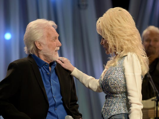 Kenny Rogers and Dolly Parton speak during pre-taping