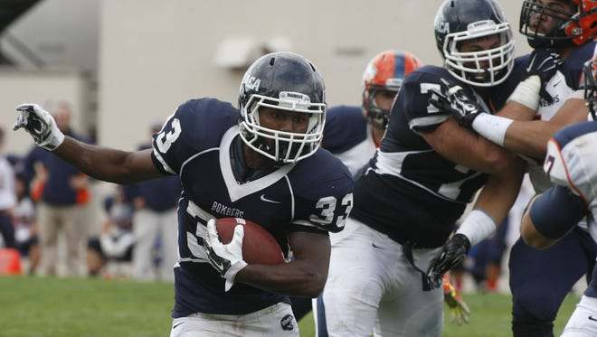 Ithaca junior running back Tristan Brown, shown in 2013 against Utica, rushed for a career-high 176 yards Saturday as the Bombers beat Alfred, 38-18.