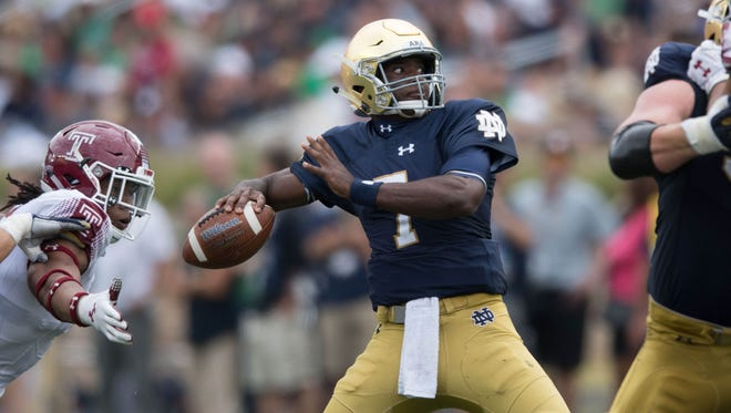 Sep 2, 2017; South Bend, IN, USA; Notre Dame Fighting Irish quarterback Brandon Wimbush (7) throws in the second quarter against the Temple Owls at Notre Dame Stadium. Mandatory Credit: Matt Cashore-USA TODAY Sports
