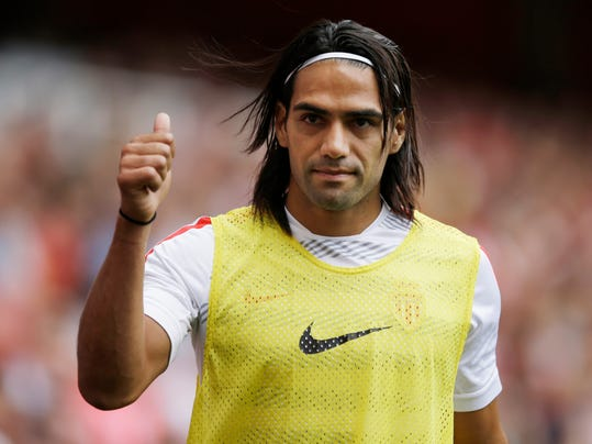 FILE - This is a Saturday, Aug. 2, 2014  file photo of AS Monaco player Radamel Falcao  as he gives a thumbs up to fans as he warms up on the sideline during the second half of the Emirates Cup soccer match between AS Monaco and Valencia at Arsenal's Emirates Stadium in London.  Radamel Falcao is set to join Manchester United on loan after the Premier League club agreed to a loan deal with Monaco, a person with knowledge of the deal said Monday Sept. 1, 2014.  (AP Photo/Matt Dunham, File)