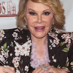Joan Rivers, promoting her book in July, has been rushed to the hospital, reports say.
