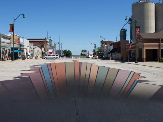 The completed Dysart gorge on Main Street. Volunteers painted the optical illusion during the hot May heat.