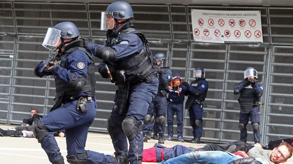 French police and volunteers take part in a security