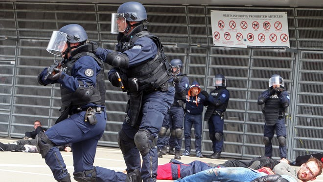 French police and volunteers take part in a security exercise at a stadium in northern France on April 21, 2016.