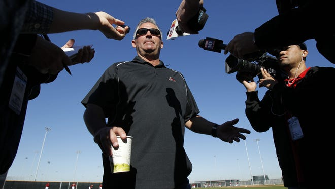 Arizona Diamondbacks GM Kevin Towers talks to the media during spring training workouts at Salt River Fields at Talking Stick in 2011.