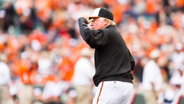 Oriole's manager Buck Showalter (26) is introduced