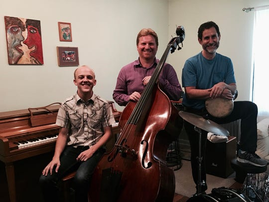 Bakan, right, stands with pianist Mason Margut and bassist Brian Hall. Together, the three make up the Bakan-Margut-Hall World Trio.