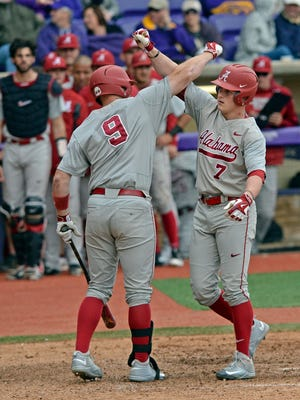 Alabama right fielder Chandler Taylor (7) and Alabama designated hitter Cody Henry (9) celebrate Taylor's two-run home run in the ninth inning of an NCAA college baseball game, Saturday, March 19, 2016, at LSU's Alex Box Stadium, Skip Bertman Field in Baton Rouge, La.