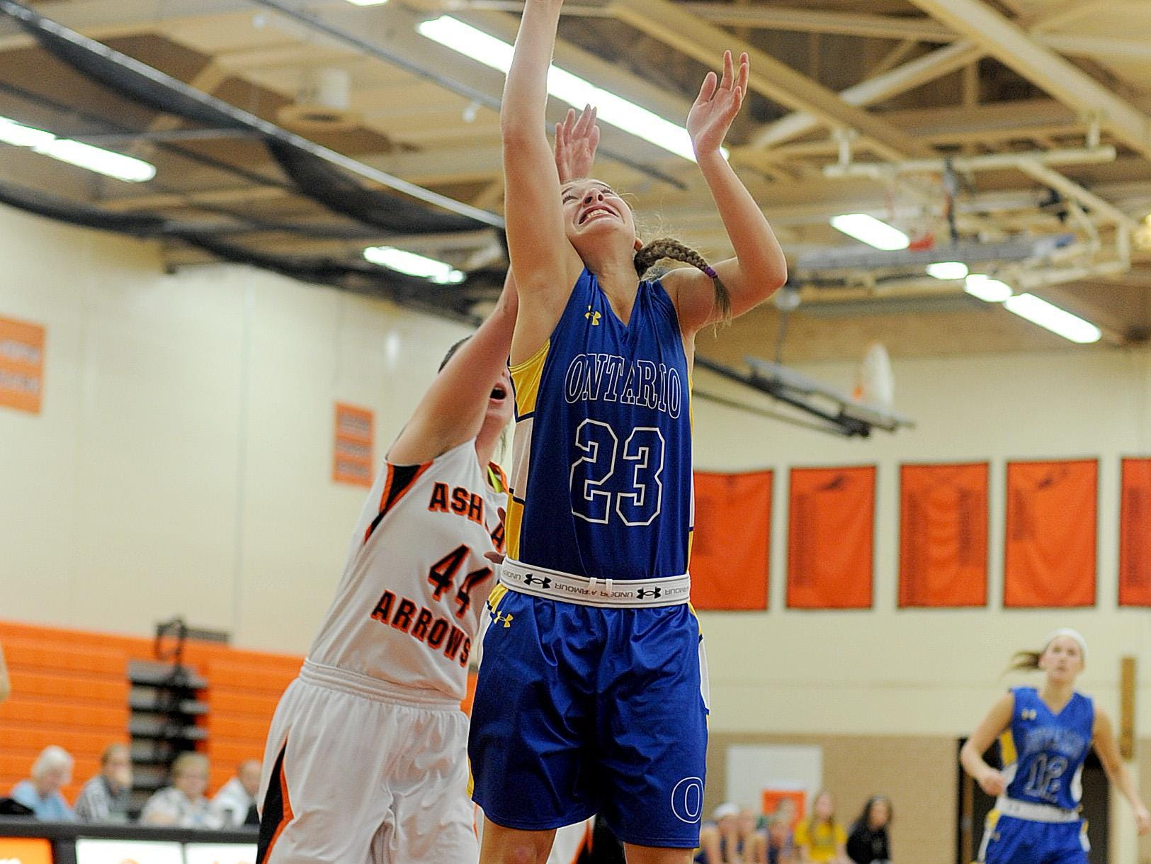 Ontario's Amanda Nething puts up a shot Tuesday night as Ashland defender Katie Kennedy closes in on her.