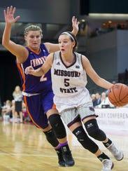 Missouri State's Liza Fruendt drives against Evansville's Kerri Glasper