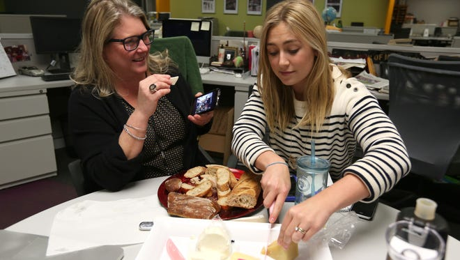Liz Johnson, left, and Megan McCaffrey taste cheese while recording the first episode of the lohudfood cast.