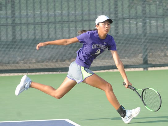 Abilene's Ruth Hill chases down a shot in her Girls' 16 Singles consolation match against Austin's Anushka Dania. Dania won 6-1, 6-0.