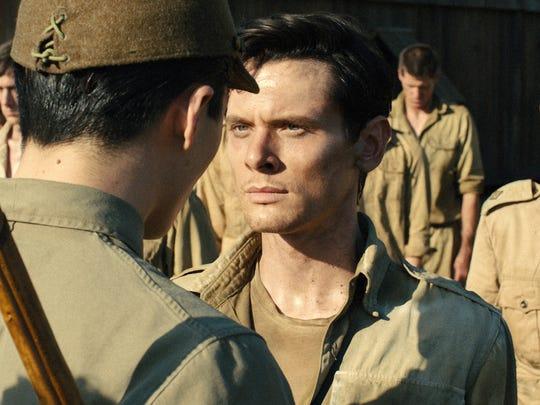 """Jack O'Connell portrays Olympian and war hero Louis """"Louie"""" Zamperini in a scene from Unbroken."""