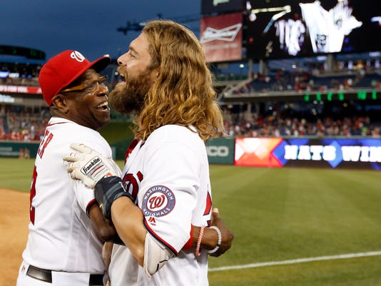 Washington Nationals manager Dusty Baker, left, celebrates with Jayson Werth after a baseball game against the Chicago Cubs at Nationals Park, Wednesday, June 15, 2016, in Washington. Werth hit the game-winning RBI single. The Nationals won 5-4, in 12 innings. (AP Photo/Alex Brandon)