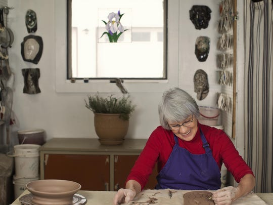"""Judy Ericksen works with clay in her Great Falls studio. Ericksen teams up with painter Steve Nelson for their """"Water, Light and Landscapes"""" exhibition running through the end of August at Gallery 16."""