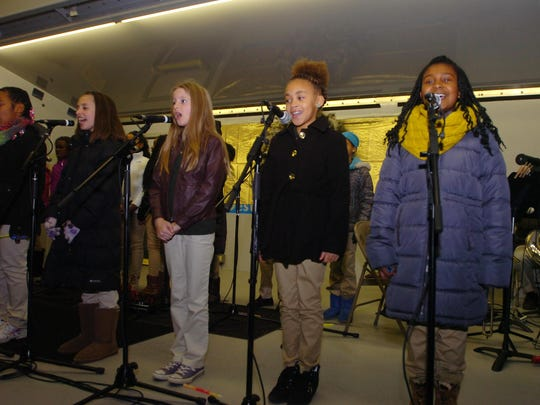 Students from Greenfield Elementary School perform holiday songs at the tree lighting ceremony.
