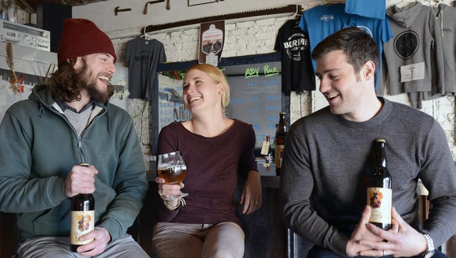 Burial Beer' will release a raspberry chocolate stout on Thursday. Pictured are    Tim Gormley, Jessica Reiser and Doug Reiser