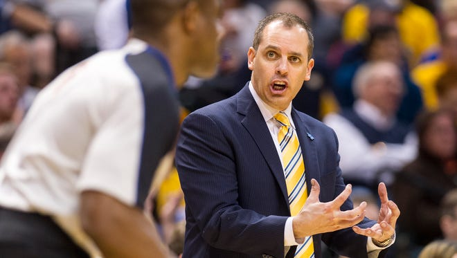 Indiana Pacers head coach Frank Vogel questions the action on the floor with an official as he runs by in the second half of action, April 2, 2014, at Bankers Life Fieldhouse. The Pacers defeated the Pistons 101-94.