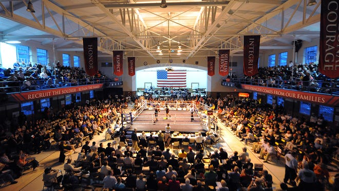 A full crowd watches the Novice-Heavyweight bout between Trevon Childs (Sweatbox) and Jon Gin Choi (Blaze Boxing) on April 17, 2014, at the Indiana Golden Gloves championship inside Tyndall Armory, Indianapolis.