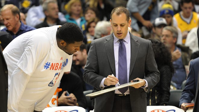 Indiana coach Frank Vogel diagrams a play for Roy Hibbert at the start of the third quarter, as the Indiana Pacers defeated the Denver Nuggets 119-80 at Bankers Life Fieldhouse Monday February 10, 2014.