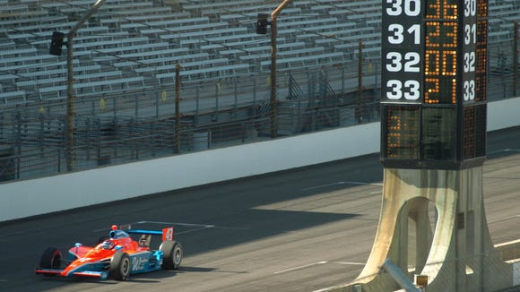 John Andretti passing the scoring pylon as he tries to make the field on bump day in 2009.