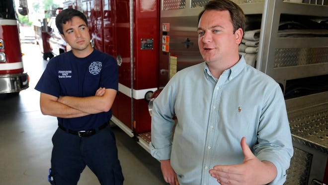 State Representative John Burris, who is a Republican candidate for state senate District 17, talks with Mountain Home firefighter Travis Dover about his platform during a Wednesday visit to Mountain Home Fire Department.