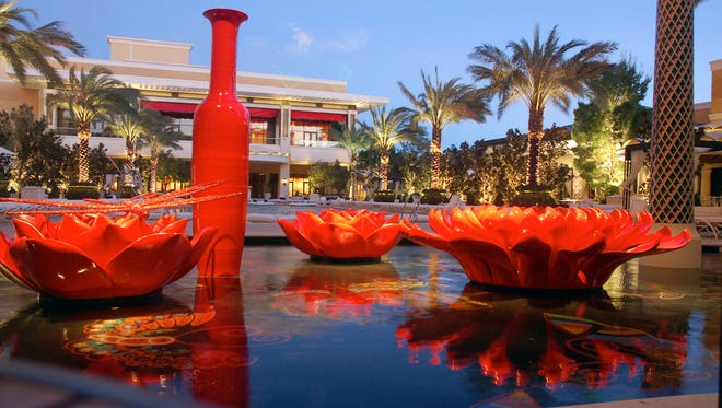 Red seems to be a favorite color motif at Encore, which boasts a 2-acre section of pools, patios, bars and several outdoor gaming tables.