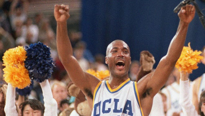 In this April 3, 1995 photo, UCLA's Ed O'Bannon celebrates after his team won the  championship NCAA game against Arkansas in Seattle. O'Bannon is a named plaintiff in a class action filed against the NCAA by current and former college athletes who allege they were not fairly compensated for use of their names and likenesses during and after their college careers.