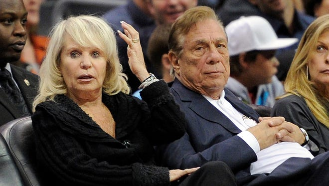 In this photo from 2010, Shelly Sterling sits with her husband, Donald Sterling, right, during a Los Angeles Clippers' basketball game against the Detroit Pistons in Los Angeles. Donald Sterling is trying to block his wife's agreement to sell the team for a record $2 billion to ex-Microsoft CEO Steve Ballmer, but Shelly Sterling's lawyers have argued Donald Sterling was found to lack the mental capacity to remain as a co-trustee of the Sterling Family Trust, which owns the team.