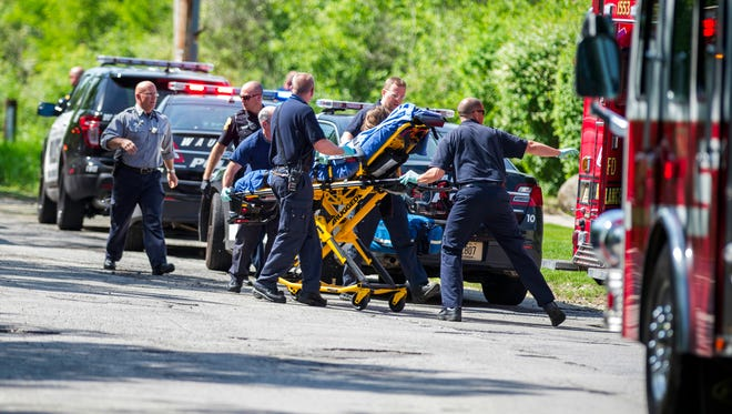 Rescue workers take a stabbing victim to an ambulance in Waukesha on May 31. Prosecutors say two 12-year-old Waukesha girls stabbed their 12-year-old friend nearly to death in the woods to please a mythological creature they learned about online. Both girls were charged as adults with first-degree attempted homicide in Waukesha County Circuit Court.