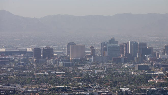 Dust fills the air in downtown Phoenix March 28, 2014.