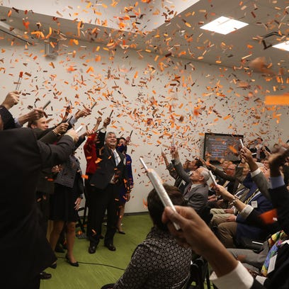 RIT officially opened it's Center for Urban Entrepreneurship on Franklin Street in Rochester.  RIT President William Destler laughs at a comment a speaker made during the press conference.