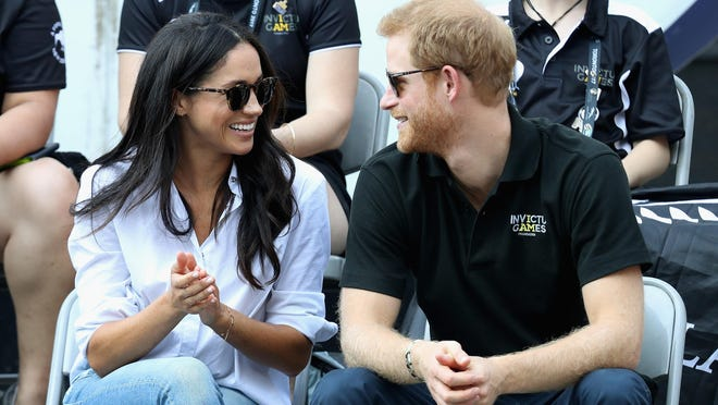 Prince Harry and Meghan Markle attend a Wheelchair Tennis match during the Invictus Games 2017 at Nathan Philips Square on Monday in Toronto.