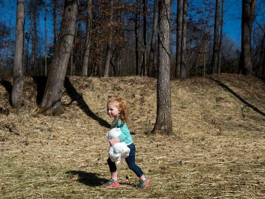 Marian Broome plays near a newly dedicated Civil War