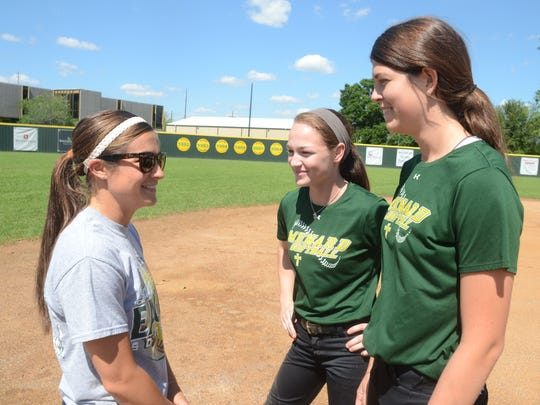Menard softball coach Allison Frye (left) talks to former players Maddie Smith and Kayla Busby during a Menard practice in 2015. At Menard, Frye led the Lady Eagles to the state tournament in Sulphur in each of her four seasons, including three championship games and the Class 2A title in 2015.