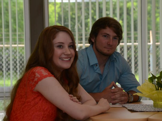 Kathryn Haston, 18 (left), with brother Zach Smith, was honored Wednesday for being the first student to complete all four years of high school online through Aiken Virtual Program. Haston has spina bifida, and the program allowed her to work at her own pace.