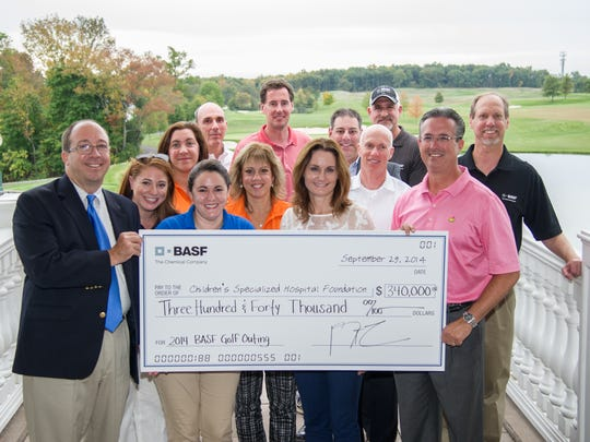 During one of their recent golf outings benefitting Children's Specialized Hospital, BASF's Golf Event Committee presented a check to Philip Salerno III, president and chief development officer of Children's Specialized Hospital Foundation.