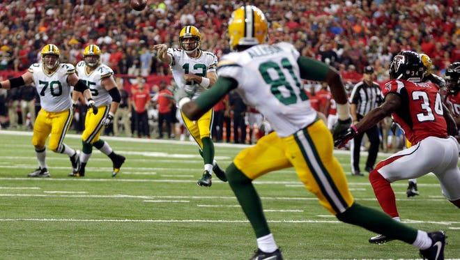 Green Bay Packers wide receiver Geronimo Allison (81) receives a touchdown pass from Green Bay Packers quarterback Aaron Rodgers (12) during the Green Bay Packers NFL game against The Atlanta Falcons, Sunday, October 30, 2016 at the Georgia Dome in Atlanta Georgia.
