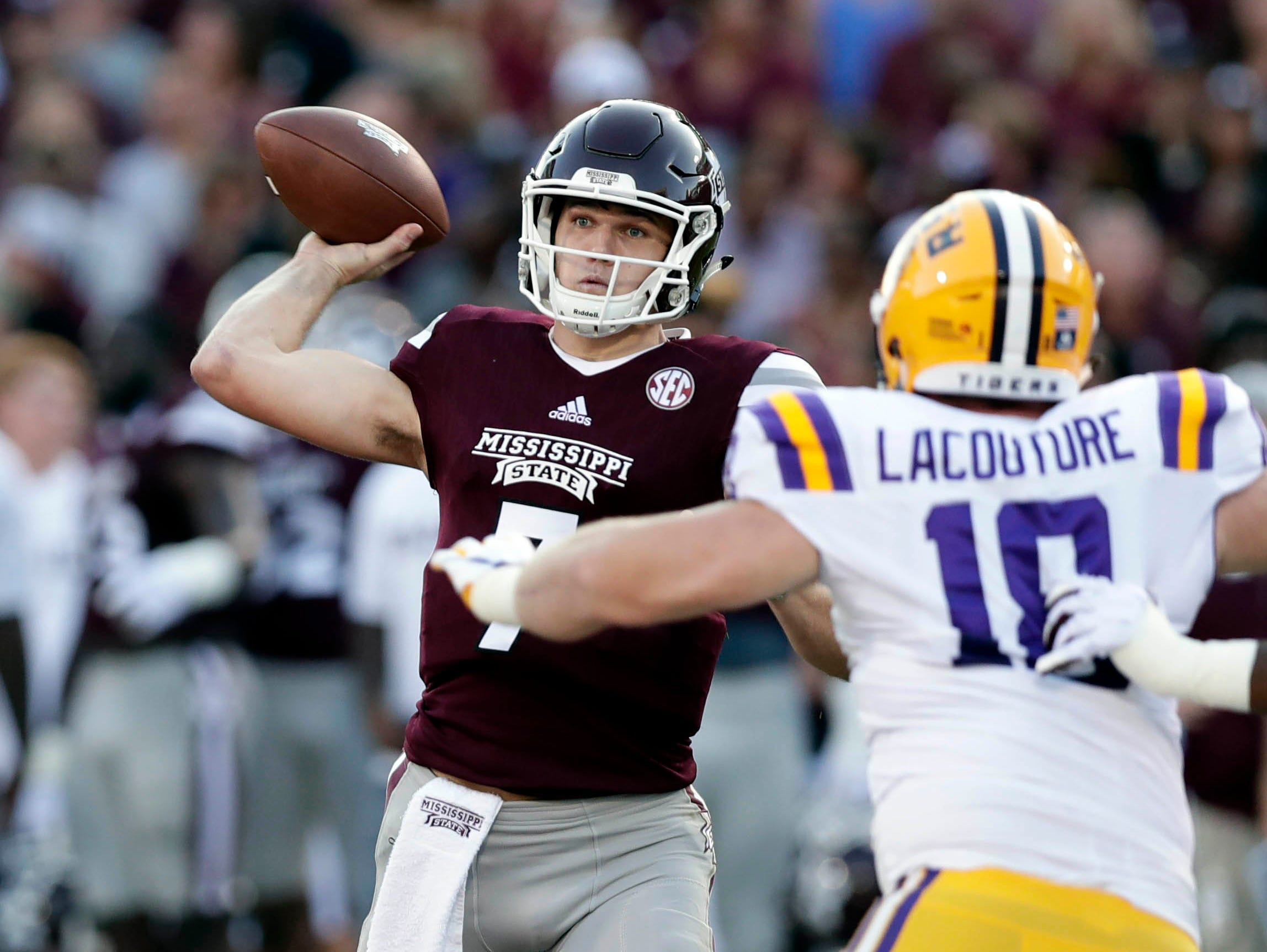 Mississippi State quarterback Nick Fitzgerald (7) attempts a pass as LSU defensive end Christian LaCouture (18) defends during the first half of their NCAA college football game against in Starkville, Miss., Saturday, Sept. 16, 2017.