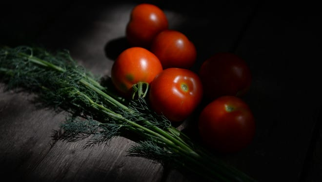 Tomatoes on a table at the Half Barn Farm on Clemens Avenue. The farm is one of the largest in the Ingham County Land Bank's garden program.