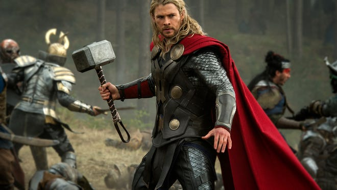 """FILE - This publicity file photo released by Walt Disney Studios and Marvel shows Chris Hemsworth in a scene from """"Thor: The Dark World."""" ?Thor: The Dark World? continued its box-office reign with $38.5 million in its second week, holding off ?The Best Man Holiday,? according to studio estimates Sunday, Nov. 17, 2013.  (AP Photo/Walt Disney Studios/Marvel, Jay Maidment, File)"""