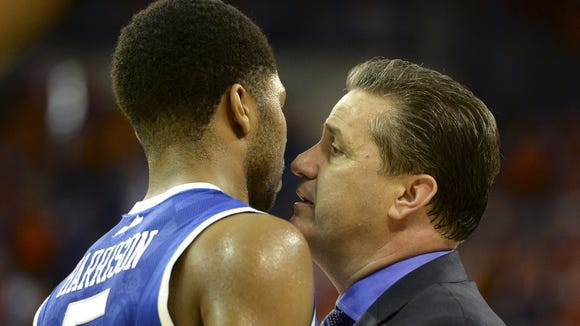 Kentucky coach John Calipari gets up close to Kentucky guard Andrew Harrison (5) during the first half of an NCAA college basketball game against Florida Saturday, March 8, 2014 in Gainesville, Fla. Florida defeated Kentucky 84-65.  (AP Photo/Phil Sandlin)